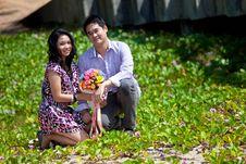 Free Couple Sitting On Beach Grass Stock Photo - 17034110