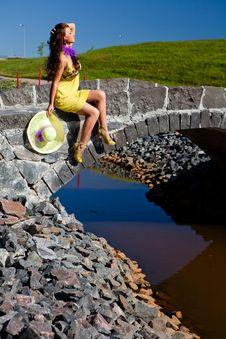 Happy Beautiful Girl Sitting On Stone Bridge Stock Images
