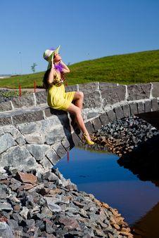 Happy Beautiful Girl Sitting On Stone Bridge Stock Image