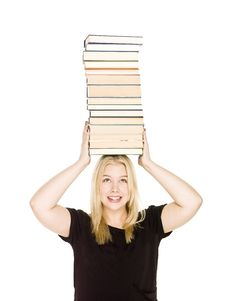 Woman With A Pile Of Books On Her Head Stock Photography
