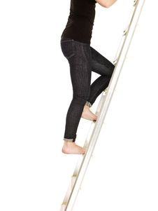 Free Woman Climbing Up The Ladder Stock Image - 17038111