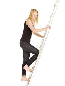 Free Woman Climbing Up The Ladder Royalty Free Stock Photography - 17038117
