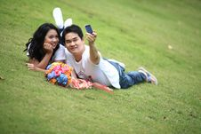 Free Couples Laying On Grass And Taking Self Portrait Royalty Free Stock Photos - 17039088