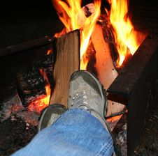 Free Feet Warming At A Camp Fire Stock Photo - 17042110