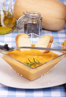 Cream Of Squash Soup In A Squared Glass Plate Royalty Free Stock Images