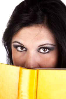 Free Woman Behind Yellow Book Royalty Free Stock Image - 17042676
