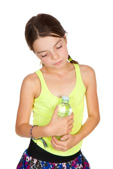 Free Thoughtful Girl Holding Bottle Of Mineral Water Stock Images - 17044604