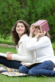 Free Smiling Student Girls On Nature Royalty Free Stock Photo - 17045735
