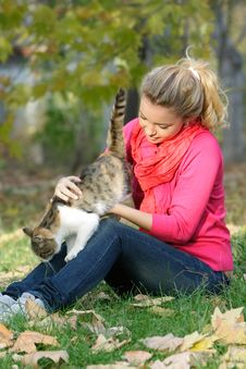 Free Young Girl With Cat Outdoors Stock Photo - 17045770