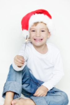 Free Santa Boy With Sparkler Over White Royalty Free Stock Photo - 17045995