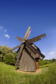 Windmill On Green Field Stock Photo