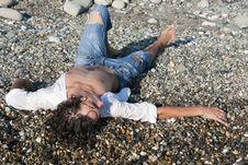 Free Young Man Lies On Coastline Stock Photo - 17050100