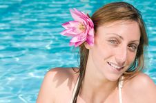 Free Smiling Young Woman With Lotus Flower Royalty Free Stock Photo - 17051575