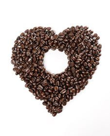 Coffee Beans In The Heart Shape Royalty Free Stock Photography