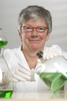 Free Scientist Is Working With A Green Liquid Royalty Free Stock Image - 17054856