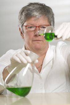 Free Scientist Is Working With A Green Liquid Royalty Free Stock Image - 17055026
