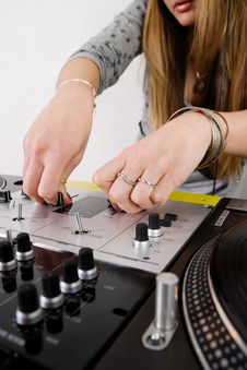 Free Female DJ Adjusting Sound Level Royalty Free Stock Photo - 17056395