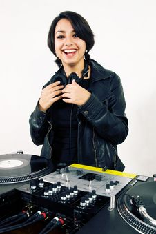 Female DJ At The Turntables Royalty Free Stock Images