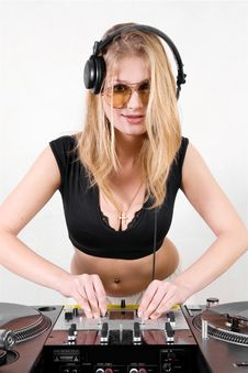 Free Female DJ Adjusting Sound Levels Royalty Free Stock Images - 17056579