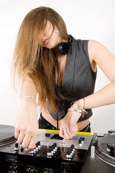 Free Female DJ Adjusting Sound Levels Royalty Free Stock Photos - 17056838