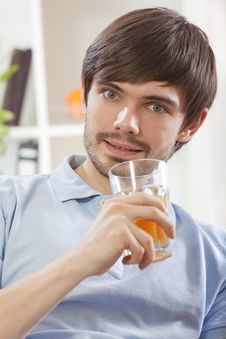 Free Man With Glass Juice Royalty Free Stock Photo - 17058455