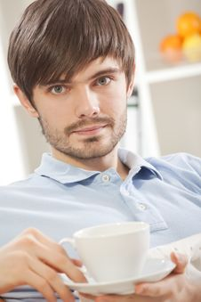 Free Man With Cup Tea On Sofa Stock Photo - 17058660
