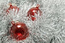 Free Red Glass Baubles On Silver Tinsel. Stock Photos - 17062823