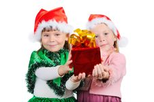 Free Two Girls In The Christmas Dress Stretch A Gift Stock Photo - 17062930
