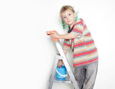 Young Boy Painting Over White Stock Images