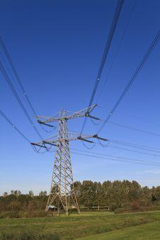 Free Electricity Pylon Aginst A Blue Sky Royalty Free Stock Image - 17064936