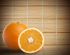 Free One And Half Oranges On Bamboo Mat Royalty Free Stock Photo - 17066135