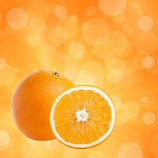 Free One And Half Oranges On Abstract Bokeh Background Royalty Free Stock Photography - 17066177