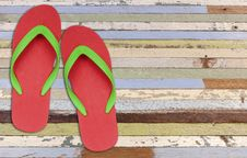 Free Red And Green Flip Flop Sandals On Old Wood Stock Photos - 17066293