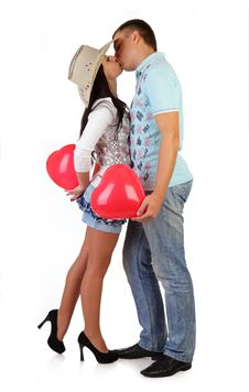 Young Couple Embraces And Holds Balloons Stock Photos