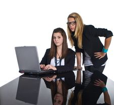 Free Teenage Business Girls Working On Black Table Stock Photography - 17069552