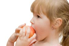 Free The Little Girl Eats An Apple Stock Photos - 17069863