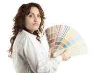 Woman In Doubt With Color Swatch Royalty Free Stock Photo