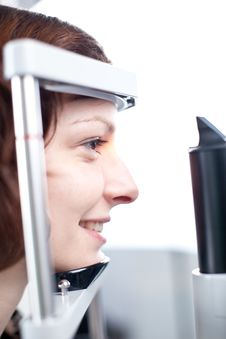 Free Young Woman Having Her Eyes Examined Royalty Free Stock Image - 17077296