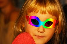 Girl In A Masquerade Mask Royalty Free Stock Photography