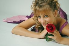 Free Woman Holding A Red Rose Royalty Free Stock Photo - 17078815