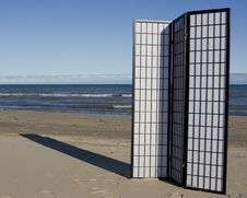 Free Three-Fold Screen On Beach Stock Images - 17080834