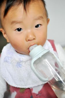 Asian Baby Is Drinking Milk Royalty Free Stock Photography