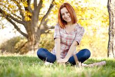 Portrait Of Red-haired Girl In The Autumn Park. Royalty Free Stock Photo