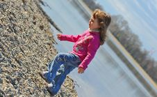 Free Little Girl Playing At The Beach In Winter Royalty Free Stock Images - 17087669