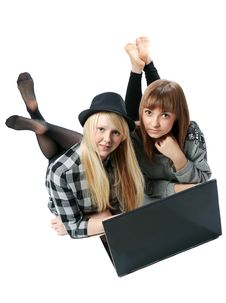 Two Girls Lies With Computer Stock Image