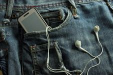 Free Mp3 Player And  Mobile Phone  In A Jeans Pocket Stock Photography - 17089732
