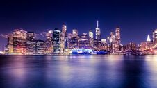 Lower Manhattan Skyscrapers From New York City Harbor At Night Royalty Free Stock Image