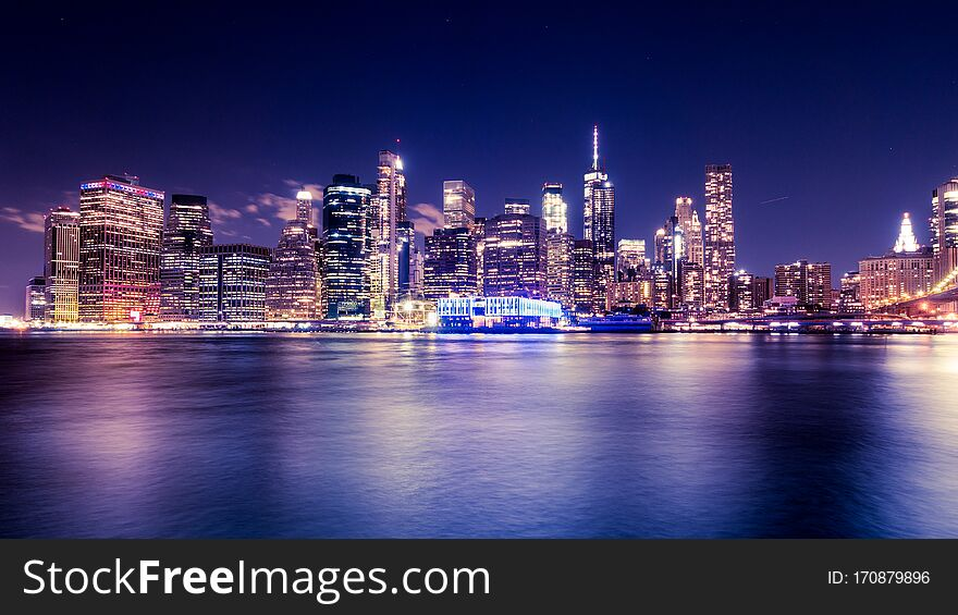 Lower Manhattan skyscrapers from New York City Harbor at night