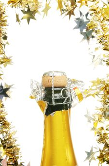 Free Champagne Bottle And Tinsel Royalty Free Stock Photos - 17090618