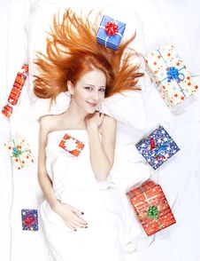 Free Happy Red-haired Girl In Bed With Christmas Gifts. Stock Photos - 17092263
